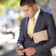 Businessman sending messages at the cellular — Stock Photo #8665928