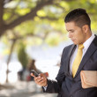 Businessmsending messages at cellular — Stock Photo #8665932