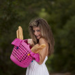 Woman with bread in the basket — Stock Photo #8666093