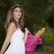 Woman with bread in the basket — Stock Photo