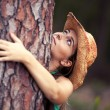 Young woman embracing a tree — Stock Photo #8666140