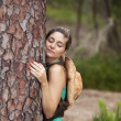 Young woman embracing a tree — Stock Photo #8666145