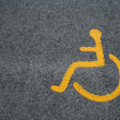 Stock Photo: Yellow Sign For Disabled Parking