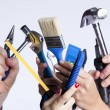 Hands with tools — Stock Photo #8666759