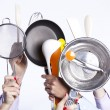 Stock Photo: Hands holding kitchenware tools