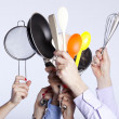 Hands holding kitchenware tools - Stock Photo