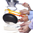 Hands holding kitchenware tools — Stock Photo #8666799