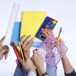 Hands holding education objects — Stock Photo #8666845