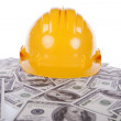 Construction helmet over a lot of money — Stok fotoğraf