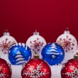 Christmas balls over a red background — Stock Photo #8668395