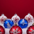 Christmas balls over a red background — Stock Photo