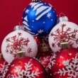 Christmas balls over a red background — Zdjęcie stockowe
