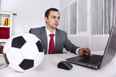 Soccer manager at the office — Stock fotografie
