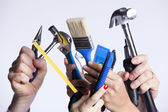 Hands with tools — Stockfoto