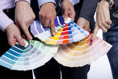 Hands pointing to color samples — Stock Photo