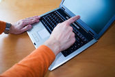 Young pointing to laptop — Stock Photo