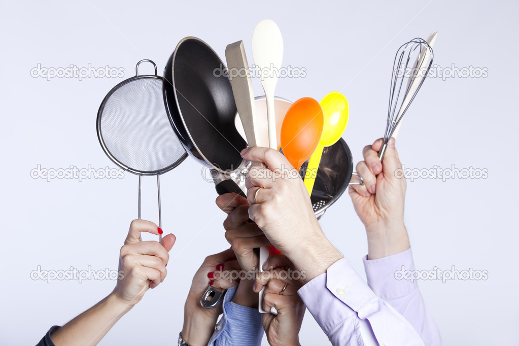Group of hands holding some kitchenware tools (selective focus) — Stock Photo #8666797