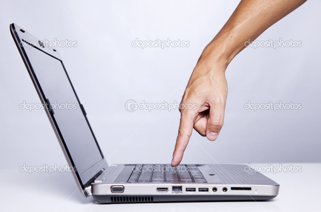 Hand gesture next to a laptop (selective focus) — Stock Photo #8668694
