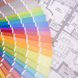 Colorful palette over a blueprint — Stockfoto