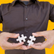 Stock Photo: Solving puzzle (focus on puzzle)