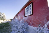 Winter red house — Stock Photo