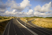 Highway on cloudy day — Stock Photo