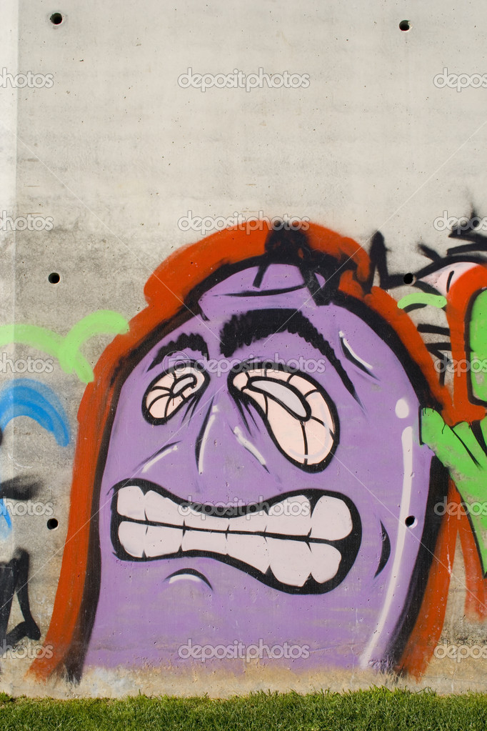 Some graffiti funny face in a concrete wall  Stock Photo #8670223