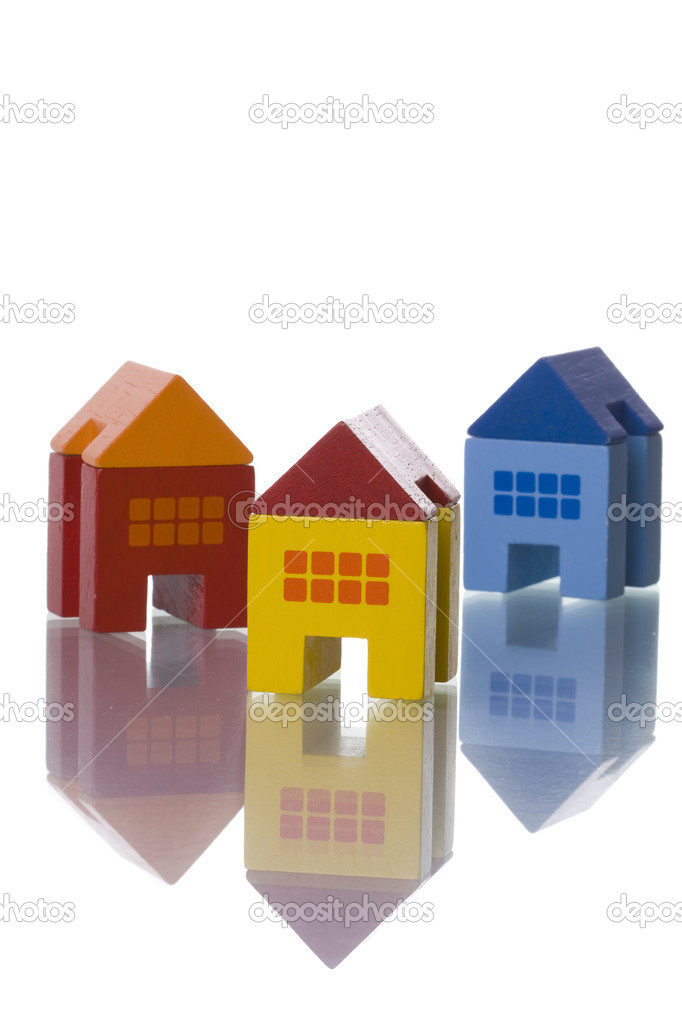 Colorful toy houses isolated on white with reflection (selective and soft focus) — Stock Photo #8670258