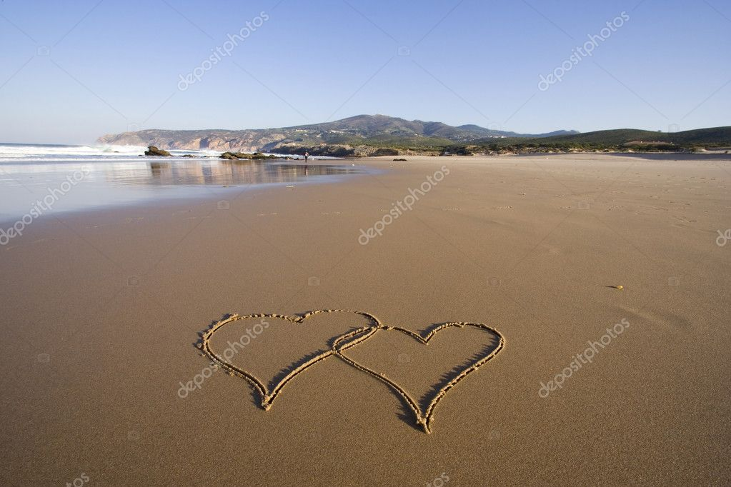Tho heart shapes writed on the beach sand — Stock Photo #8671845