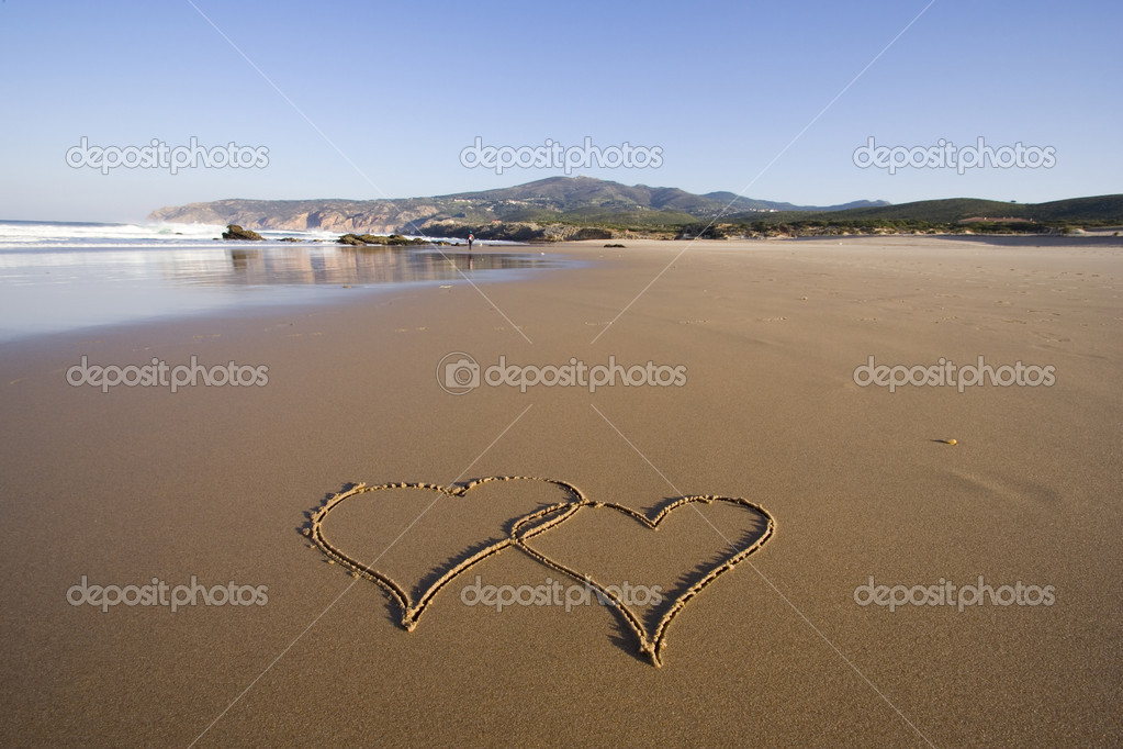 Tho heart shapes writed on the beach sand — Stok fotoğraf #8671845