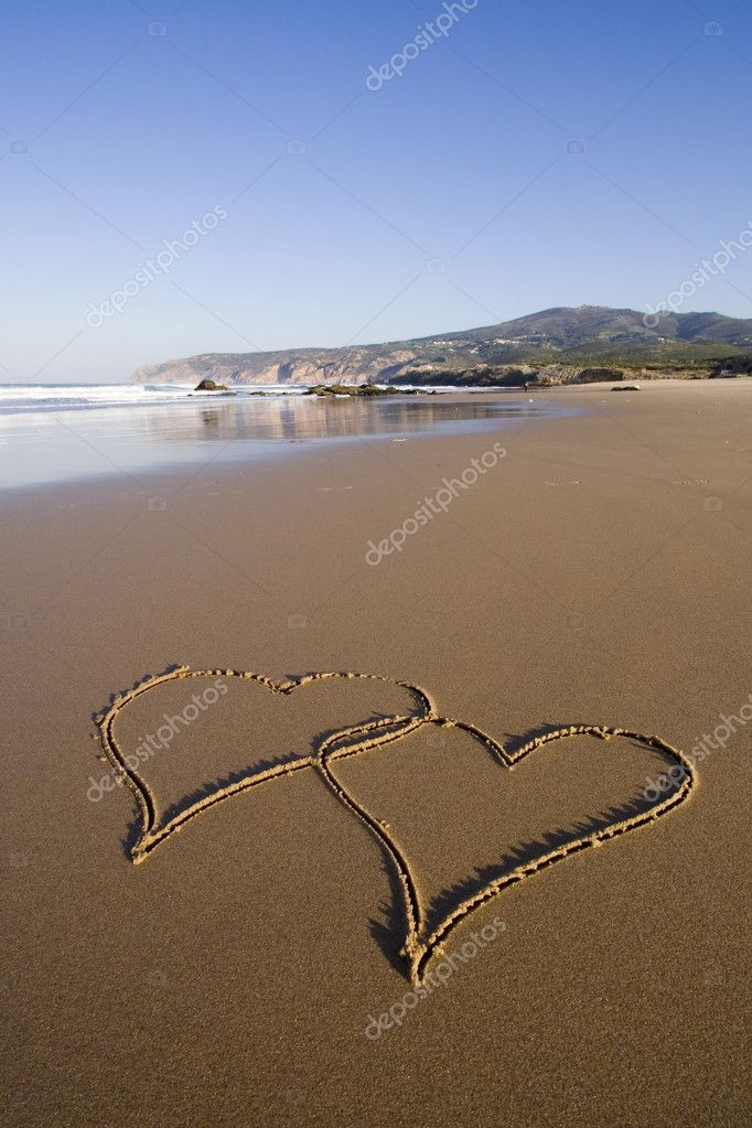 Tho heart shapes writed on the beach sand — Stock Photo #8671849