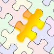 Glossy yellow puzzle on paper — Stock Photo #10252300