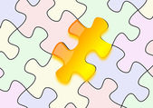 Glossy yellow puzzle on paper — Stock Photo