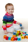 Redhead little girl with blocks — Stock Photo