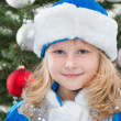 Cheerful little girl at the christmas tree — Stock Photo #8089309