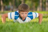 Training athletic boy — Stock Photo