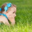 Royalty-Free Stock Photo: Little girl on the green lawn