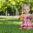 Royalty-Free Stock Photo: Little girl with toys in the park