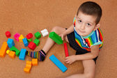 Boy playing vivid toy blocks — Stock Photo