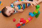 Lottle boy playing toy blocks — Stock Photo