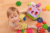 Toddler among toys — Stock Photo
