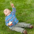 Toddler showing the plain in the sky - Foto Stock