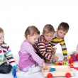 Stock Photo: Five children playing toys