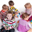 Five children playing colorful toys — Stock Photo #8143473