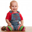 Happy sitting toddler in casual clothes — Stock Photo