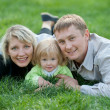 Family of three enjoying last summer days - Stock Photo
