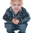 Smiling toddler sits down — Stock Photo #8143956