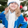 Happy Snowmaiden at the christmas tree — Stock Photo
