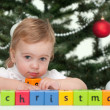 Toddler at a merry christmas tree — Stock Photo