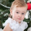 Pretty toddler at the new year tree — Stock Photo #8143998